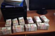 У дельцов изъяли 950 тысяч гривен. Фото: Сергей Билан/Facebook